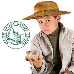 little kid explorer examining large cristal / presious gem